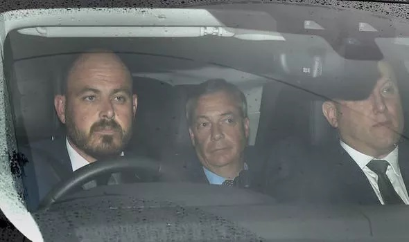 Farage in car