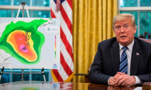 Trump with hurricane map