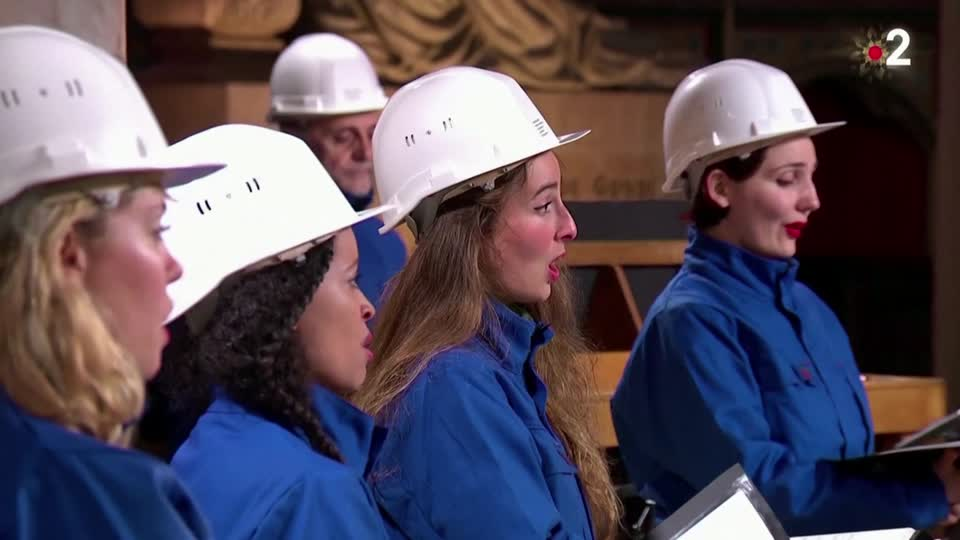 Notre Dame choir in hard hats